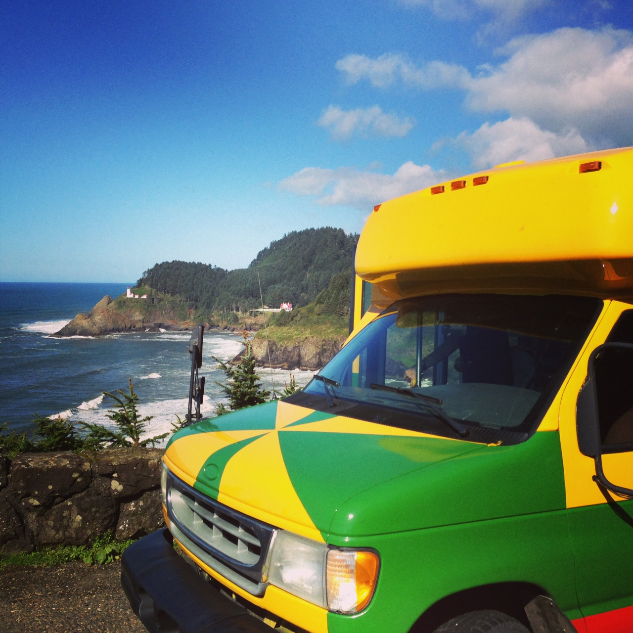Pegasus shuttle bus at Heceta Head lighthouse on the Oregon Coast